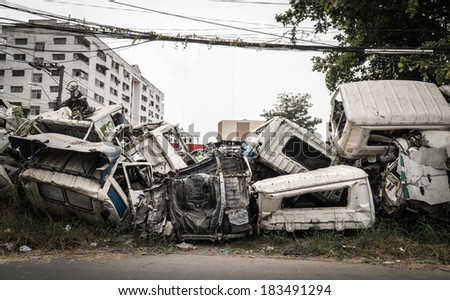 Crushed truck in car graveyard - stock photo