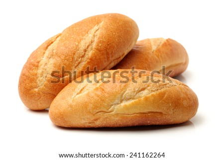 crusty mini baguettes on white surface - stock photo
