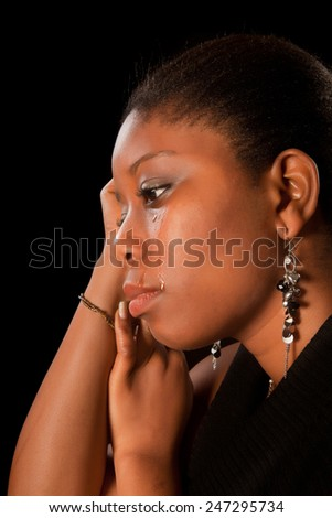 Crying african ghanese young woman shedding tears - stock photo