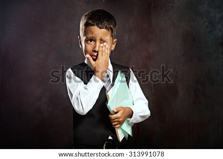Crying afro american pupil - stock photo