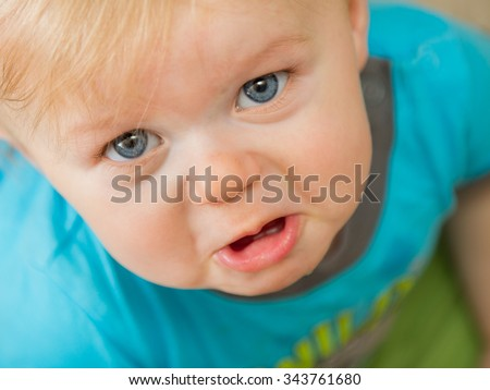 Crying and making a sad little face - stock photo