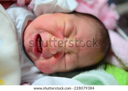 Crying Asian new born. - stock photo