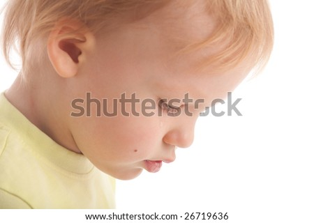 Crying baby. Boy shed a tear. Isolated on white - stock photo