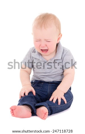 crying baby boy sitting isolated on white background - stock photo