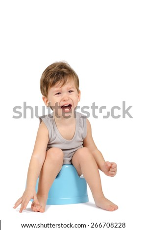 Crying baby boy sitting on a blue potty isolated on white background