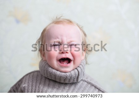 crying baby in a warm sweater