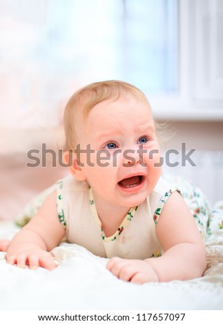 Crying baby on a light background