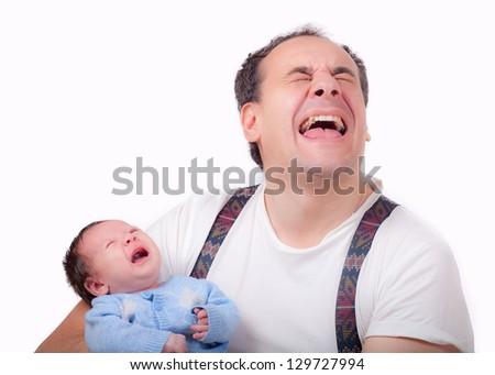 crying baby with a father - stock photo