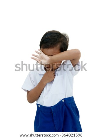 Crying boy in school uniform - stock photo