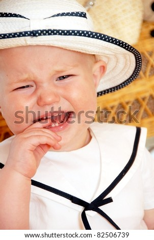 Crying child with hat - stock photo