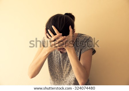 Crying depressed hysterical young woman, dramatic portrait  - stock photo