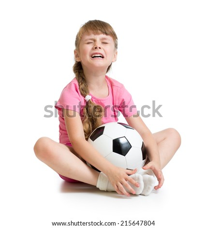 Crying girl with soccer ball isolated on white - stock photo