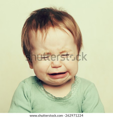 Crying little baby, 6 months old - stock photo