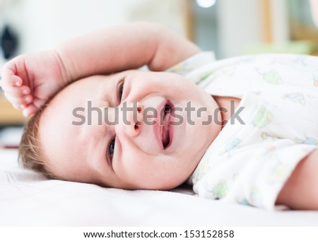 Crying newborn baby boy - stock photo