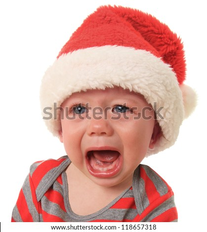 Crying Santa baby boy, 10 months old. - stock photo