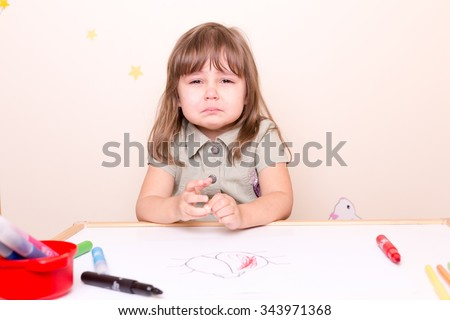 crying small girl at school - stock photo