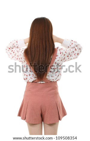 Crying standing young woman, back view
