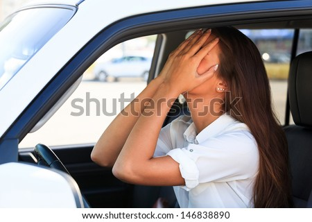Crying woman in a car  - stock photo