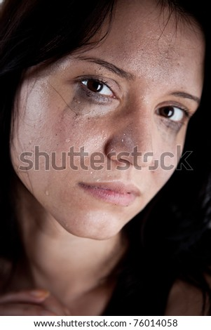 crying young woman, hostage closeup