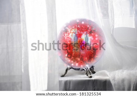 crystal ball illuminated with red from inside  - stock photo