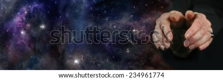 Crystal Ball Reading on deep space background - Clairvoyant with cupped hands hovering over a crystal ball on a deep space background - stock photo