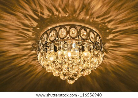 Crystal ceiling chandelier glowing and iridescent. - Crystal Ceiling Chandelier Glowing Iridescent Stock Photo