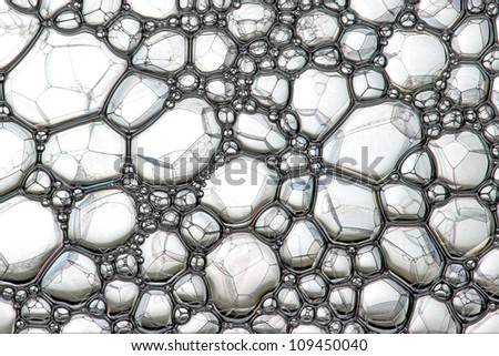Crystal cells Description: Soap bubbles on the water - stock photo