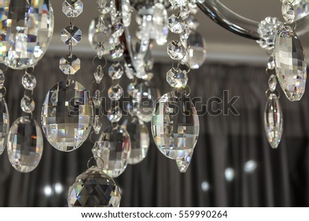 crystal chandelier in a white room in the style of Artdeko / Crystal Chandelier