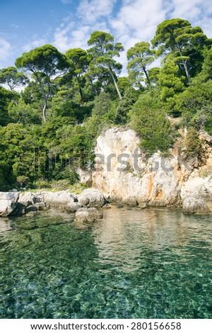 Crystal clear Adriatic waters along the rugged Mediterranean rock shore of Lokrum Island off the coast of Dubrovnik, Croatia - stock photo