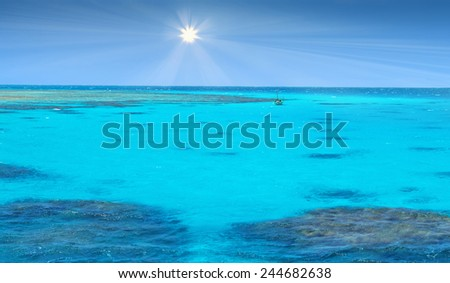 Crystal clear blue coral water of a Red Sea  - stock photo