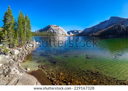 Crystal clear lake and mountains reflection, USA - stock photo