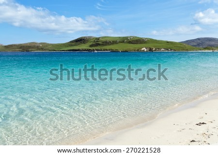 Crystal clear sea on a scottish beach . Isle of Vatersay, Western Isles, Scotland - stock photo