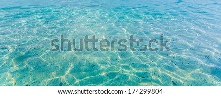 Crystal clear sea water at tropical island - stock photo