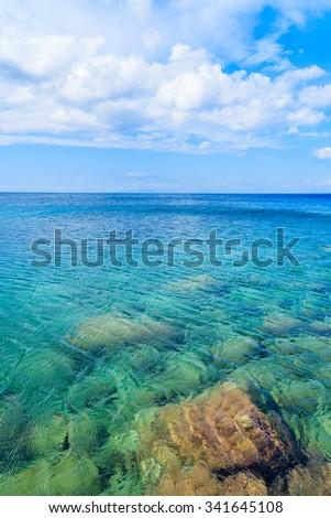 Crystal clear sea water of Aegean Sea at Kokkari beach, Samos island, Greece - stock photo