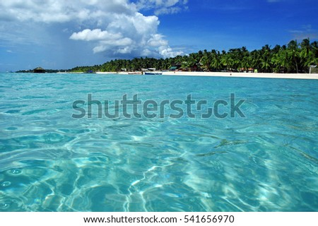 Crystal clear Turquoise water and white sand beaches of a tropical Island