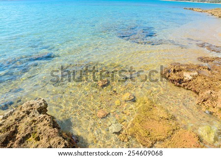 crystal clear water in Mugoni beach, Alghero - stock photo