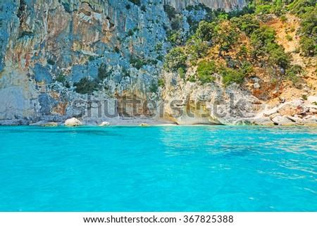crystal clear water in Orosei Gulf, Sardinia - stock photo