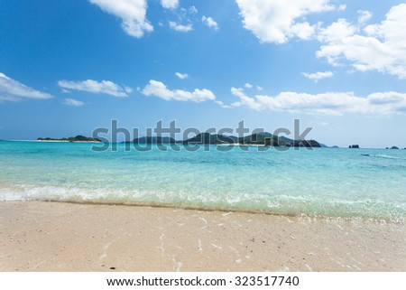 Crystal clear water wave lapping on tropical beach, Zamami Island of the Kerama Islands National Park, Okinawa, Japan - stock photo