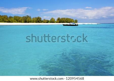 Crystal clear waters at Zanzibar beach in Tanzania - stock photo