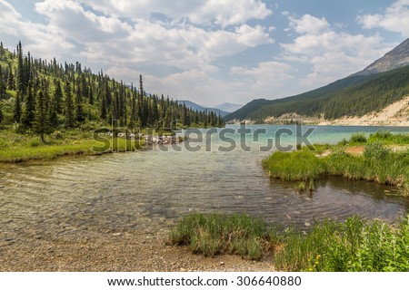 Crystal clear waters of Summit Lake along the Alaska Highway in Northern BC  - stock photo
