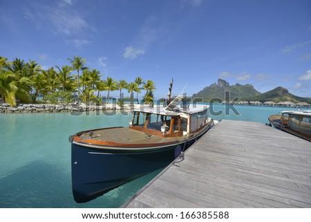 Crystal clear waters of tropical Bora Bora in Bora Bora, French Polynesia - stock photo