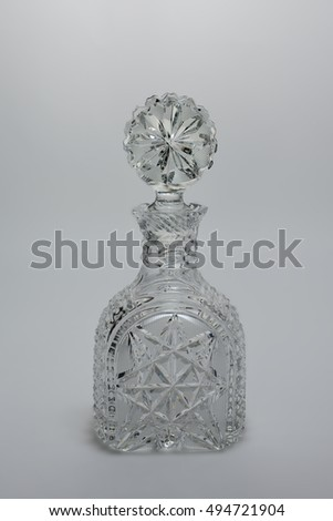 crystal decanter on a gray background
