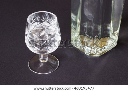 Crystal glass and the bottle on a dark background