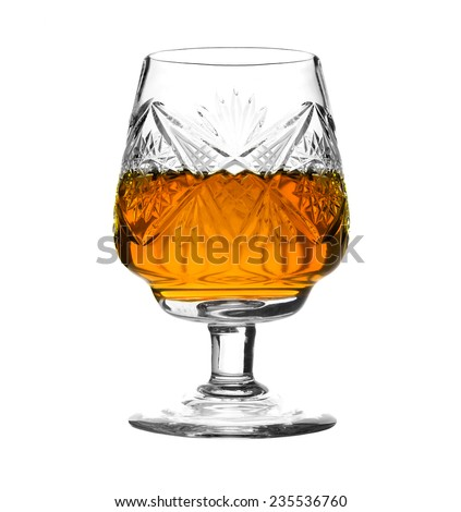 Crystal glass with brandy isolated on white background - stock photo