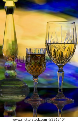 Crystal glasses on abstract color background - stock photo