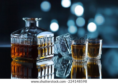 crystal glasses with whiskey on a dark background  - stock photo