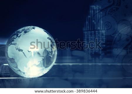 Crystal globe on laptop keyboard - stock photo