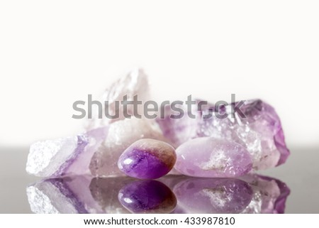 crystal healing Stone amethyst, uncut and tumble finished, concept therapie and engery - stock photo