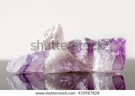 crystal healing Stone amethyst, uncut, concept therapie and engery - stock photo