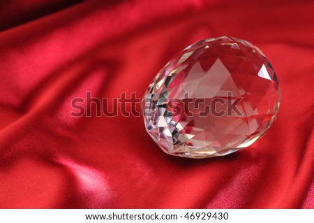 crystal lies in the atlas on a red background
